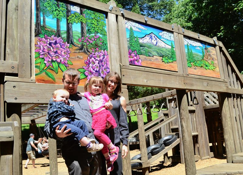 POST PHOTO: BRITTANY ALLEN - Karin Hoffman is a local painter and mother who recently contributed artwork to beautify the side of the Fantasy Forest play structure in Meinig Park.