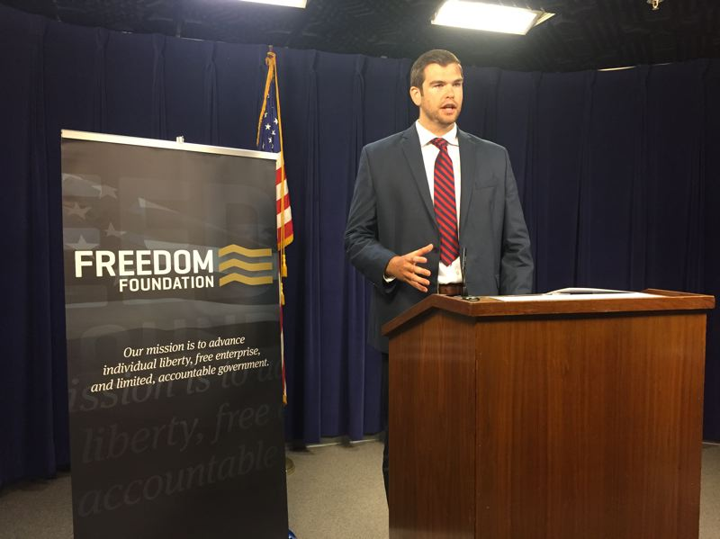 PARIS ACHEN/CAPITAL BUREAU - Aaron Withe, Oregon director of the Freedom Foundation, speaks to reporters at the Oregon State Capitol in Salem July 2, 2018.
