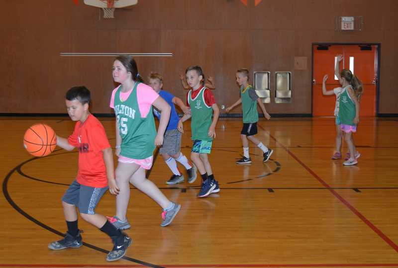 PIONEER PHOTO: CINDY FAMA - The 23rd Colton Hoop Camp for grades K-9 included skills practice and games.