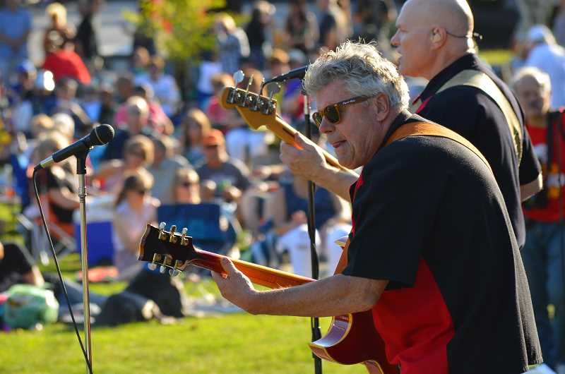 SPOKESMAN FILE PHOTO - Rouke vanDerVeen, left, and Grady McKenzie of Johnny Limbo and the Lugnuts peformed at the Rotary Club of Wilsonville's Summer Concerts series in 2017 for the 12th consecutive year.