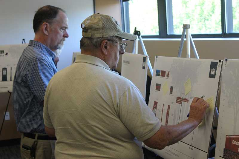 SPOKESMAN PHOTOS: COREY BUCHANAN - Citizens weighed in on design options for wayfinding signs at June 26 open house.