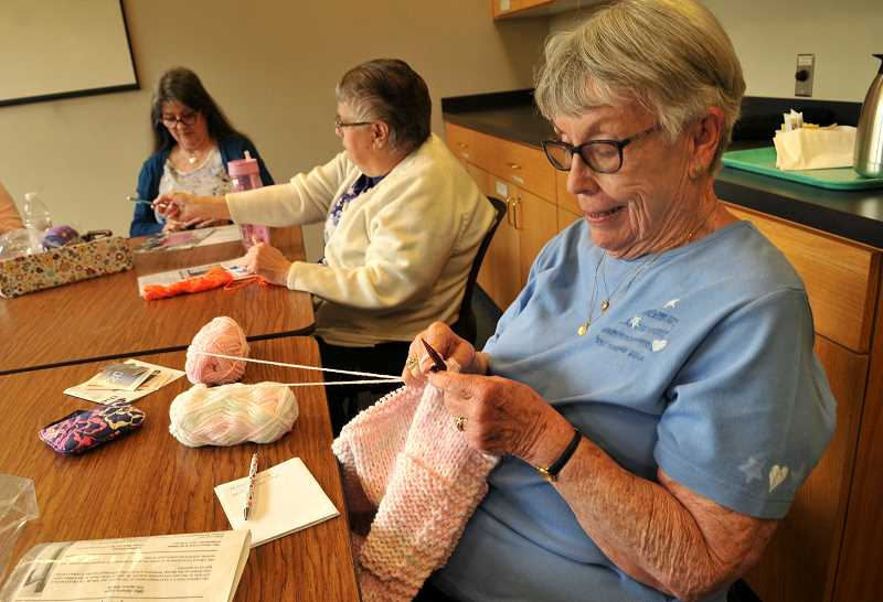 Mary Kay Meyers of Wilsonville works on a baby blanket.