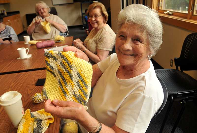 Wilsonvilles Dolores Mouck holds up one of her finished dish clothes