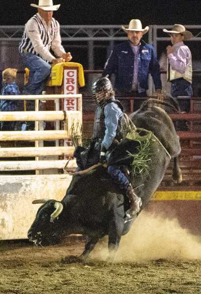 LON AUSTIN/CENTRAL OREGONIAN - Derek Kolbaba of Walla Walla, Washington, rides Thug Life for a score of 79 on Friday night. Kolbaba's ride was good enough to place fourth overall in the event.