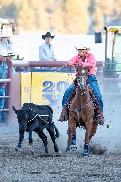 LON AUSTIN/CENTRAL OREGONIAN - Jenna Johnson of Warm Springs completes her breakaway roping run in 2.8 seconds Thursday night at the Crooked River Roundup. Johnson's time was good for second place overall in the inaugural running of the event at the Crooked River Roundup. This year's Roundup saw huge crowds attend the three-day event, which ended Saturday night.