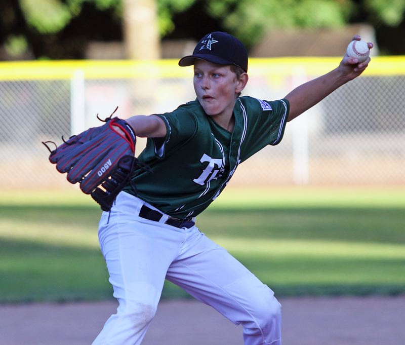 TIMES PHOTO: DAN BROOD - Tigard Little Leagues Alex Pearson throws a pitch during the top of the sixth inning of Mondays district tournament semifinal game.