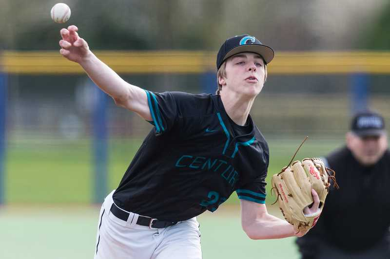 STAFF PHOTO: CHRISTOPHER OERTELL - Century's Ian Lawson throws a pitch during a Jaguar game last season at Ron Tonkin Field. The Century baseball team is forced to play the bulk of their games at the Gordon Faber Recreational Complex due to poor field conditions at Century High.