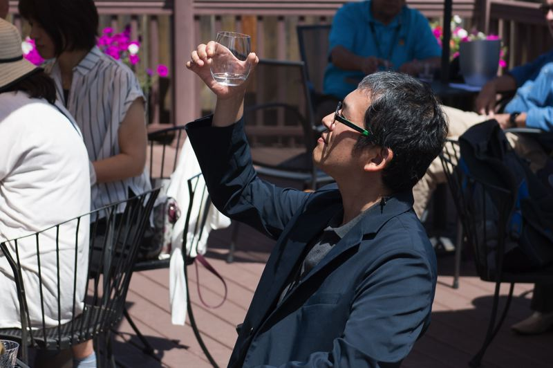 STAFF PHOTO: CHRISTOPHER OERTELL - A delegate from Nyuzen, Japan, Forest Grove's sister city, samples sake on Tuesday, July 3.