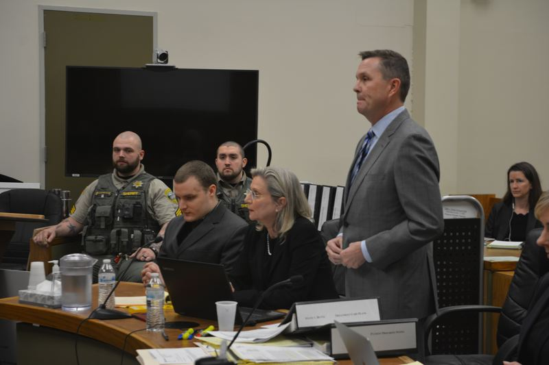 SPOTLIGHT FILE PHOTO - Daniel A. Butts (second from left) appears in a Columbia County courtroom alongside his attorneys, Dianna Gentry and Patrick Sweeney during a hearing in February. A judge ruled July 3 that the defendant is competent enough to aid and assist in his own defense.