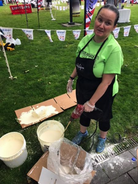 TIMES PHOTO: DANA HAYNES - Julie Barry uses an industrial plaster mixer to blend the pancake batter.