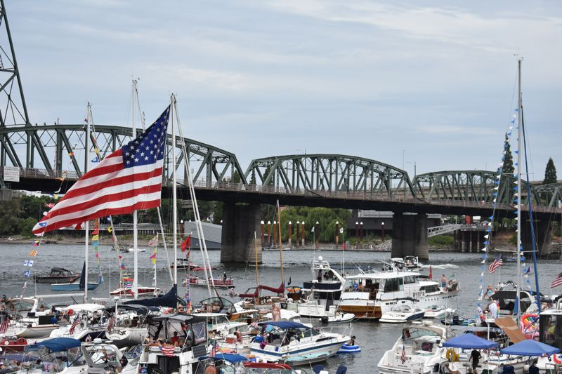 PAMPLIN MEDIA GROUP: HAILEY STEWART - Boat's park at the waterfront for the day to listen to the more than 20 performances and hold their spots for the fireworks show at Tom McCall Waterfront Park Wednesday afternoon.