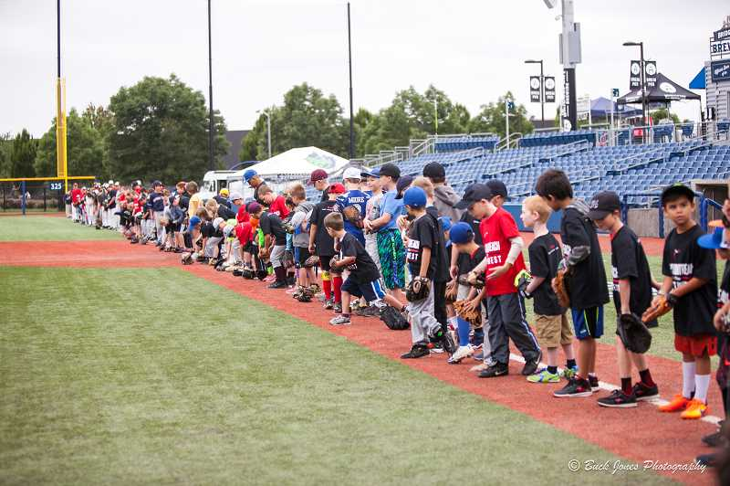 COURTESY PHOTO - Kids line up for a drill at a Sports Outreach Northwest baseball clinic held at Ron Tonkin Field earlier this year.