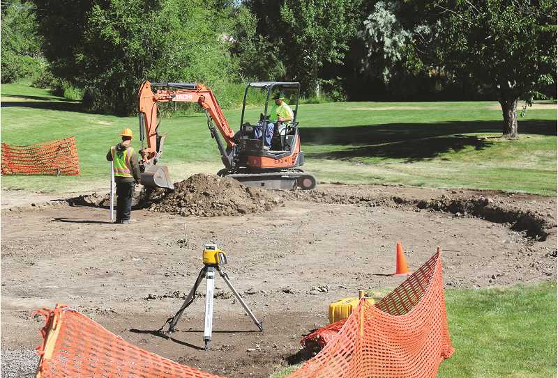 JASON CHANEY - SMAF construction workers excavate the area the new splash pad will eventually occupy at Stryker Park.