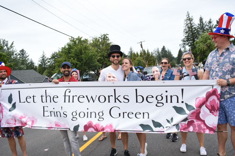 OUTLOOK PHOTO: MATT DEBOW - Couple Erin Kerns and Caleb Green, center, were surprised by this float celebrating their engagement during the during the Corbett Fun Fest Parade on July 4. Kerns and Green plan on getting married on Saturday, July 7.