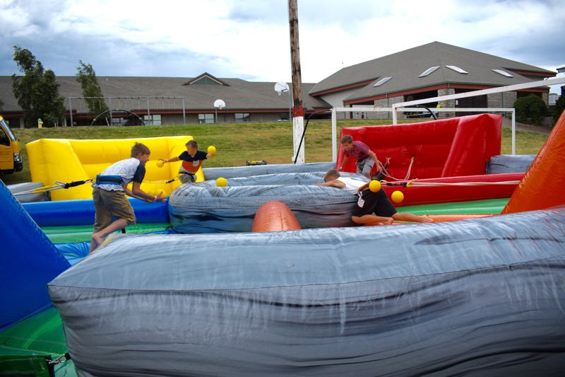 OUTLOOK PHOTO: MATT DEBOW - Kids play a game of life-size Hungry, Hungry Hippos at the Corbett Fun Fest grounds following the parade on Wednesday, July 4.