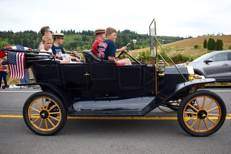 OUTLOOK PHOTO: MATT DEBOW - An antique car makes its way down the route for the Corbett Fun Fest Parade on July 4.