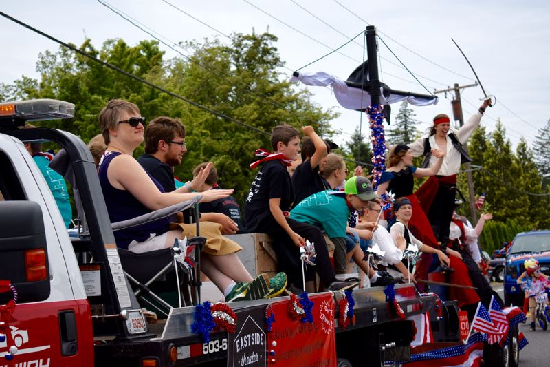 OUTLOOK PHOTO: MATT DEBOW - The Eastside Theater Company acts out a pirate-themed scene during the Corbett Fun Fest Parade on July 4.