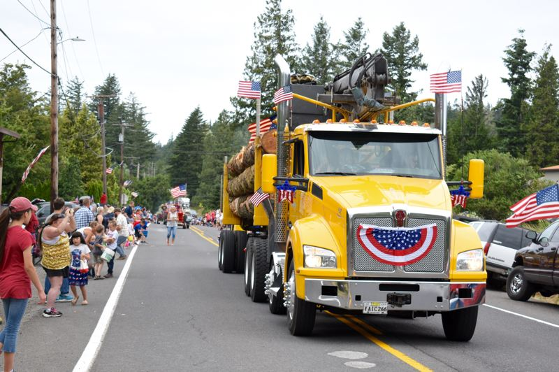 OUTLOOK PHOTO: MATT DEBOW - A decorated fire truck travels down the parade route for the annual Corbett Fun Fest Parade on July 4.