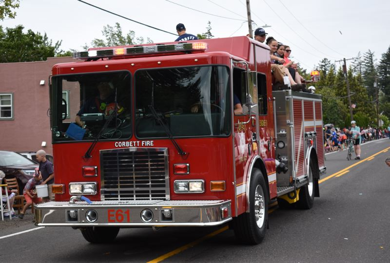 OUTLOOK PHOTO: MATT DEBOW - A fire engine from the Corbett Fire District closes the parade on Wednesday, July, 4.