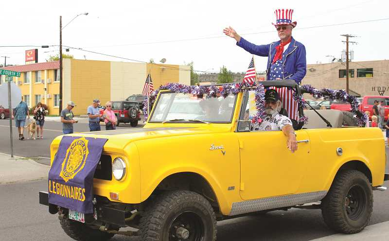 JASON CHANEY/CENTRAL OREGONIAN - Uncle Sam waves to the Prineville parade crowd as part of the American Legion float.