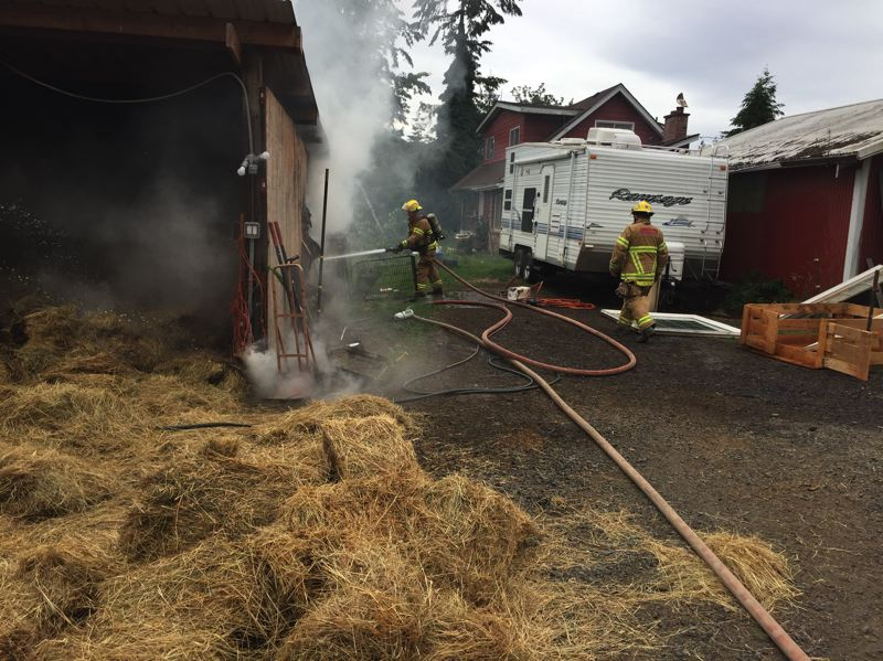 PHOTO COURTESY OF COLUMBIA RIVER FIRE AND RESCUE - Columbia River Fire and Rescue crews responded to a barn fire in Goble on June 27 when more than 100 bales of hay burned, spreading to the barn where the bales were stored. The homeowner was trying to exterminate rats with a propane torch when it caused hay stored nearby to catch fire.