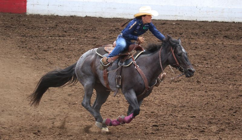 PAMPLIN MEDIA: JIM BESEDA - Reigning world champion barrel racer Nellie Miller of Cottonwood, California posted a winning time of 17.28 seconds during the Fourth of July matinee performance at the 95th Molalla Buckeroo PRCA Rodeo.