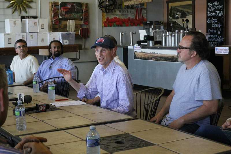 LINDSAY KEEFER - Sen. Ron Wyden talks to a roundtable of people in the hemp industry Thursday at Wooden Shoe Tulip Farm about the importance of industrial hemp being legalized at the federal level.