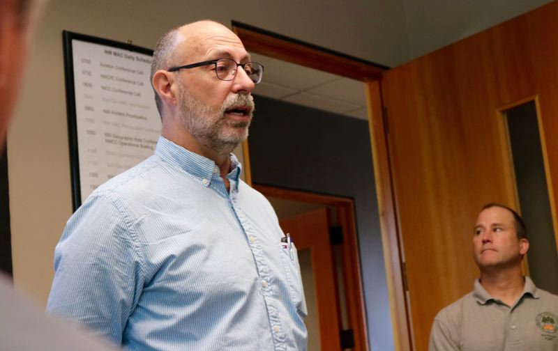 TRIBUNE PHOTO: ZANE SPARLING - Dan O'Brien, center manager for the Northwest Interagency Coordination Center, speaks during a meeting with Sen. Ron Wyden on Friday, July 6.