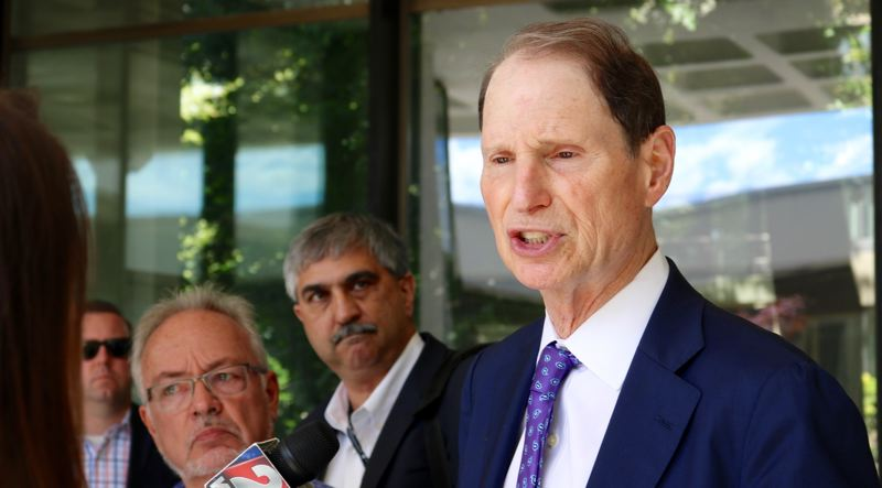 TRIBUNE PHOTO: ZANE SPARLING - Sen. Ron Wyden, D-Oregon, speaks with reporters outside the Northwest Interagency Coordination Center on Southwest Harrison Street in downtown Portland on Friday, July 6.