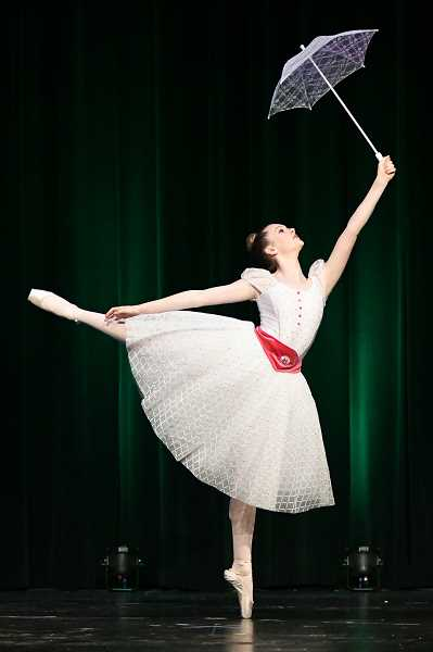 PHOTO CURTESY OF SPORTS PLUS PHOTOS/DAVID WEAVER - Hannah Kelso performs a ballet solo at the annual recital.