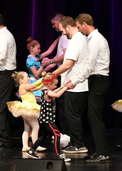 PHOTO CURTESY OF SPORTS PLUS PHOTOS/DAVID WEAVER - Innovative Dance's 20th anniversary and annual recital kicked off with the 'Dad's Dance.'