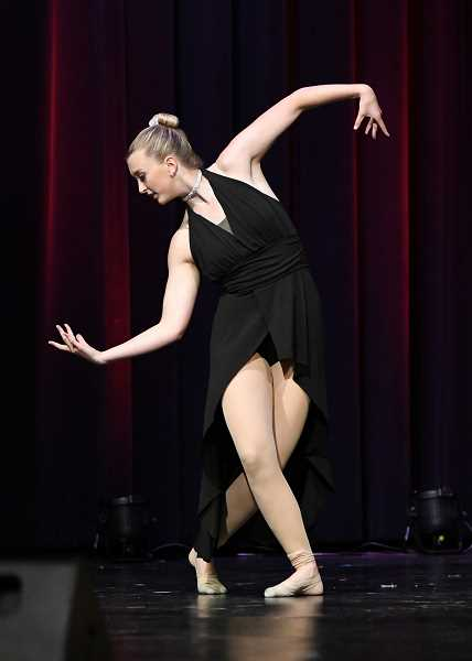 PHOTO CURTESY OF SPORTS PLUS PHOTOS/DAVID WEAVER - Hayley May performs a solo at the annual recital.