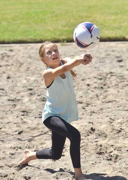 SPOKESMAN PHOTO: VERN UYETAKE  - Isabella Kampfe works on her skills at the Skyhawks volleyball camp at Memorial Park.