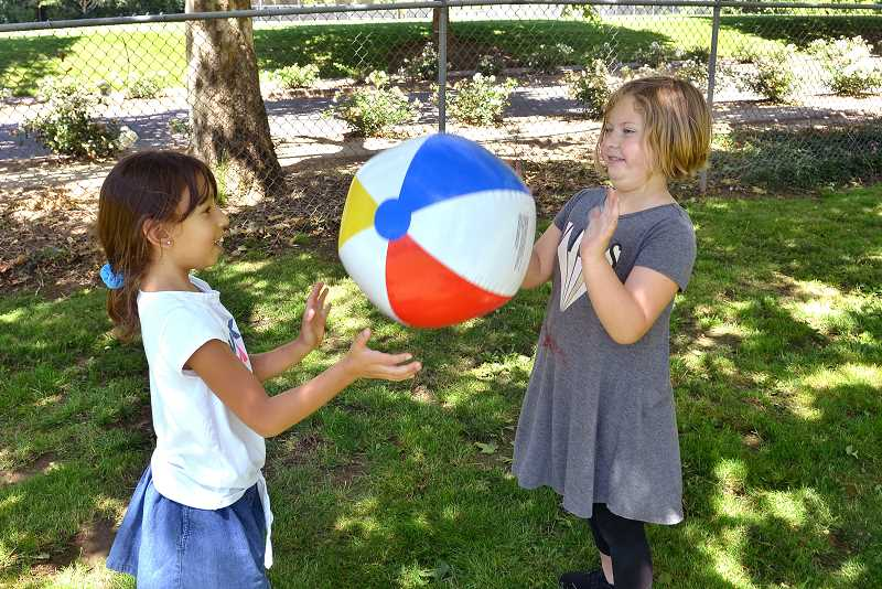 TIDINGS PHOTO: VERN UYETAKE  - Zoe Leik, left, and Sophia Sottilare see how long they can bat the beach ball back-and-forth during the Fun in the Sun camp.
