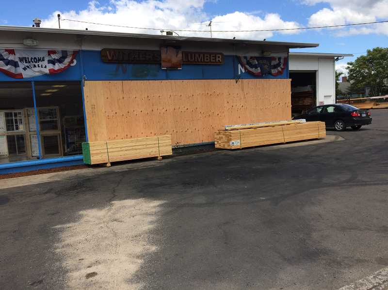 PIONEER PHOTO: CAROL ROSEN - The July 4 fire damaged the front of the Withers Lumber building.