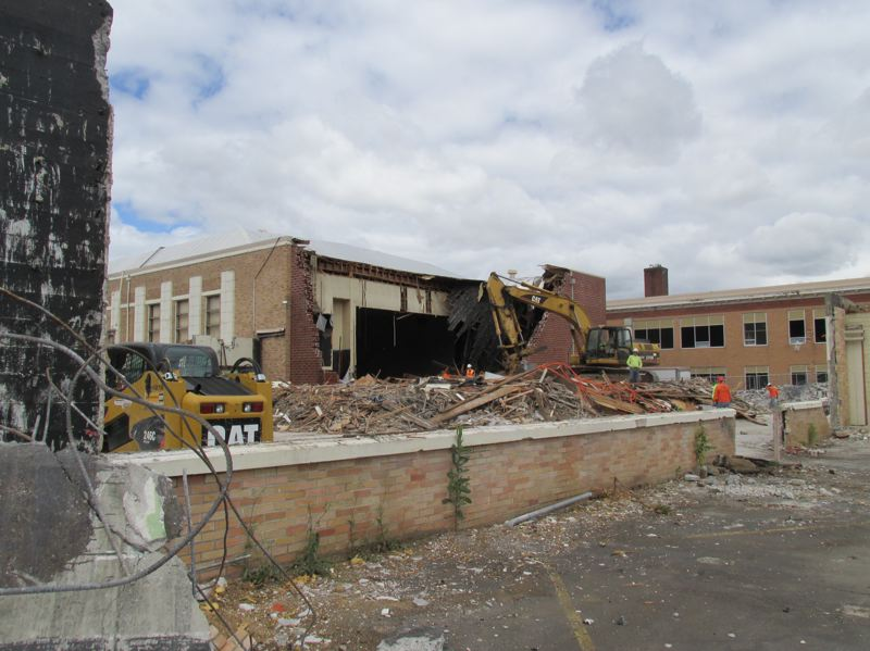 OUTLOOK PHOTO: TERESA CARSON - Workers were beginning to demolish auditorium at Gresham High School on Monday, July 2. The new high school theater will move to the corner of Division Street and Main Avenue, creating a strong statement at that busy intersection.