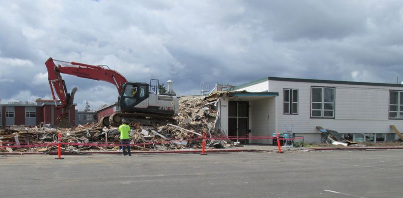 OUTOOK PHOTO: TERESA CARSON - Workers begin to demolish Wilkes Elementary School as a new school is being finished in the background.
