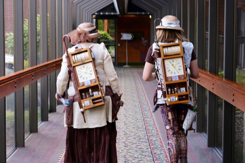 TRIBUNE PHOTO: ZANE SPARLING  - Peggy Wenham and her granddaughter wear matching 'time travel' devices on their backs at GEAR Con on Saturday, July 7.