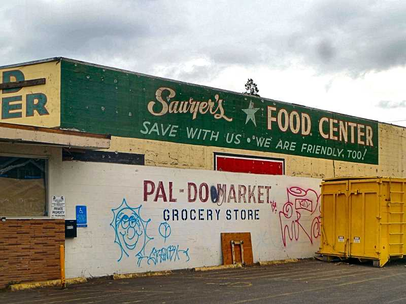 EILEEN G. FDITZSIMONS - A BEE reader alerted us that historic signs were recently uncovered on the front and sides of the grocery store at S.E. 61st and Foster Road, as the site is redeveloped into a different type of business, very close to what will become a Multnomah County shelter.