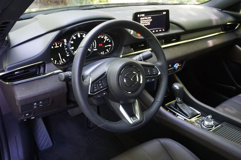 PORTLAND TRIBUNE: JEFF ZURSCHMEIDE - The interior of the 2018 Mazda6 is cleanly styled and can be loaded up with the latest automotive technologies.