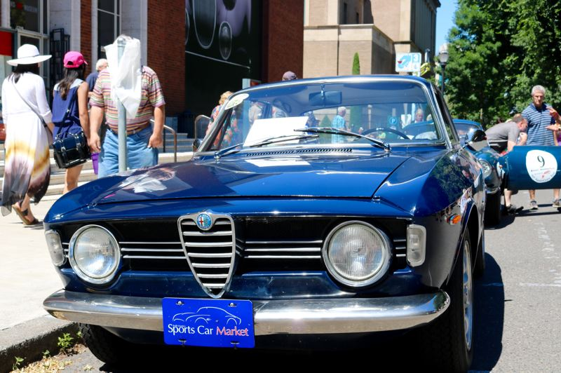 TRIBUNE PHOTO: ZANE SPARLING - The 1967 Alfa Romeo GTV is displayed at 'Cars in the Park' on Sunday, July 8.