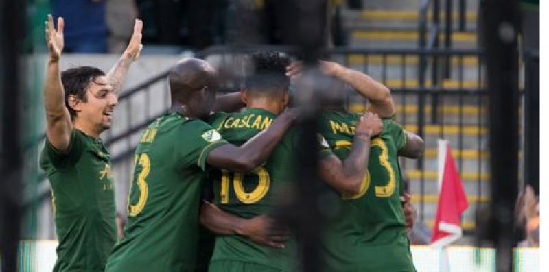 TRIBUNE PHOTO: KIT MACAVOY - The Portland Timbers celebrate Samuel Armenteros' first of two goals in Saturday 2-1 win against the San Jose Earthquakes.