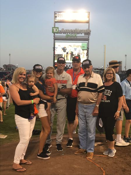 COURTESY: YESKIE FAMILY - Oregon State pitching coach Nate Yeskie celebrates with his family, including grandfather Bob (second from right), after the Beavers' College World Series championship in Omaha, Nebraska.