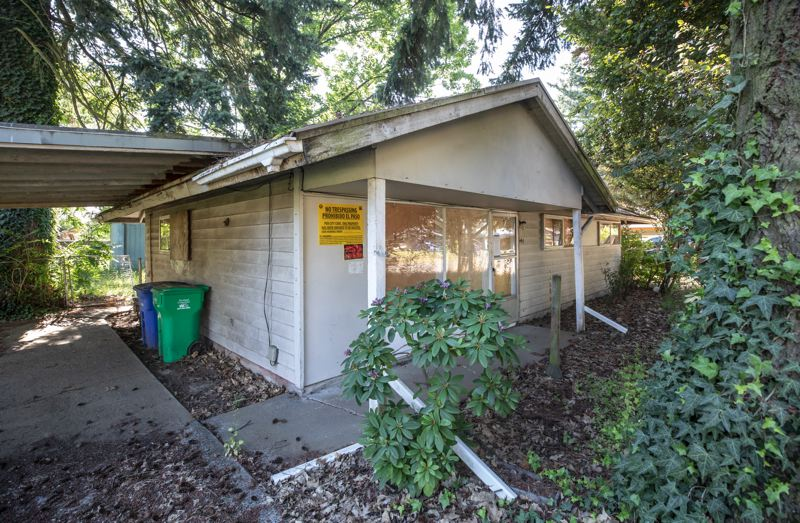 PORTLAND TRIBUNE: JONATHAN HOUSE - The zombie home at 544 S.E. 137th Ave. is one of 10 derelict properties in Portland owned by Norman Yee. On Aug. 8, the City Council will consider whether to foreclose on it and three others he owns.