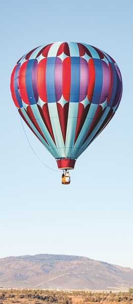 JAMIE WOOD/CENTRAL OREGONIAN - Jeff Beebe's balloon, Making Friends, graces the Prineville skies.
