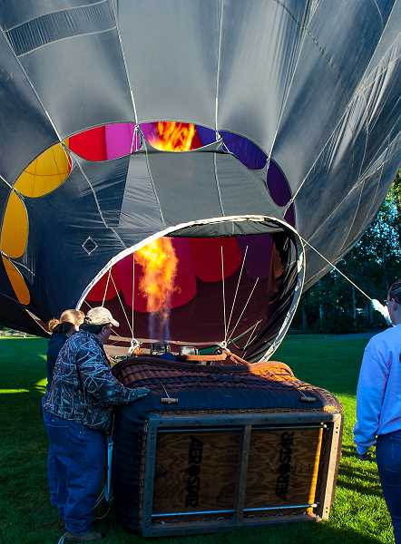 JAMIE WOOD/CENTRAL OREGONIAN - A crew helps Robert Rapper fill his balloon, Redemption, for an early Saturday morning flight.