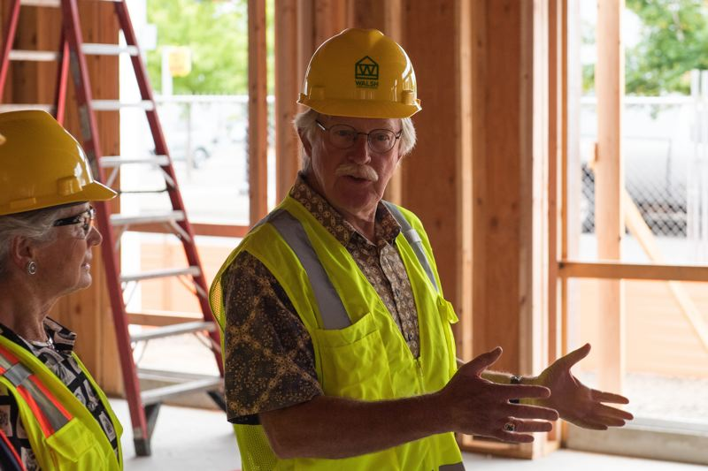 STAFF PHOTO: CHRISTOPHER OERTELL - Cornelius Library Foundation President Richard Meyer speaks during a tour of the Cornelius Place building on Monday, July 9.
