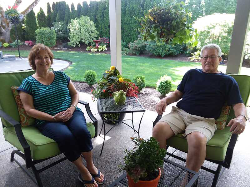 Charlotte and Chuck Hammack enjoy time outside in their yard.