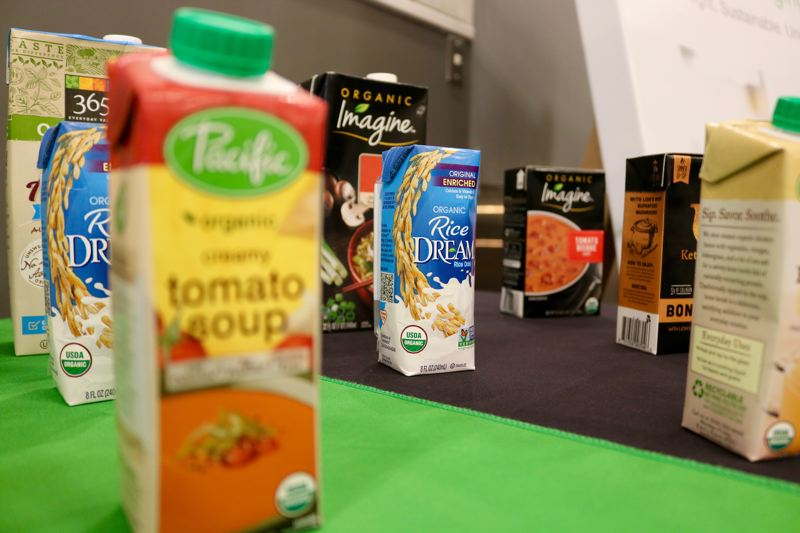 TRIBUNE PHOTO: ZANE SPARLING - A variety of products that use BillerudKorsnas packaging were displayed during the Solutions 2018 conference at the Oregon Museum of Science and Industry on Monday, July 9.