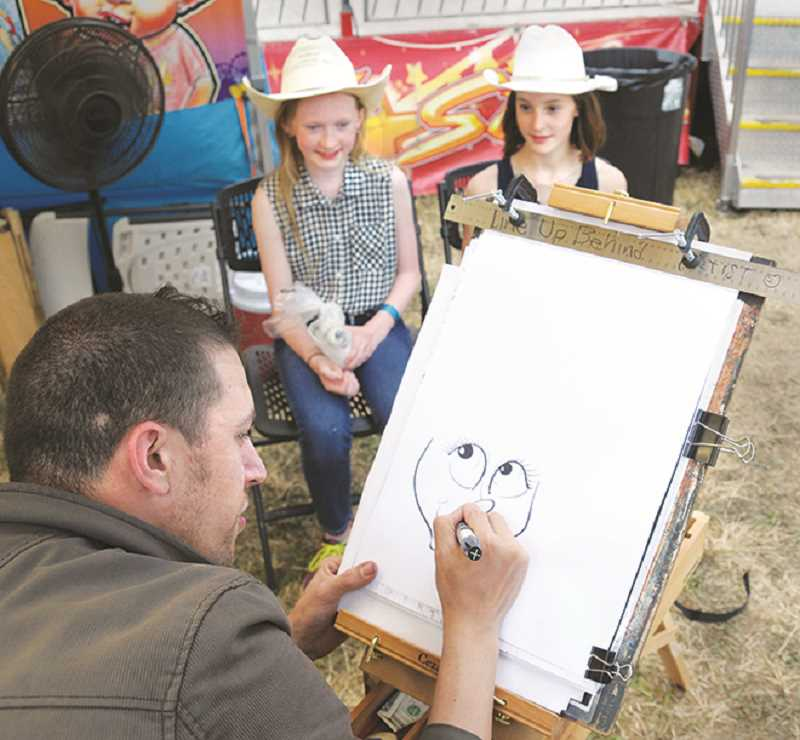 GARY ALLEN - Ben Bloss of the Draw Some Faces company sketches a portrait commissioned by two young cowgirls.